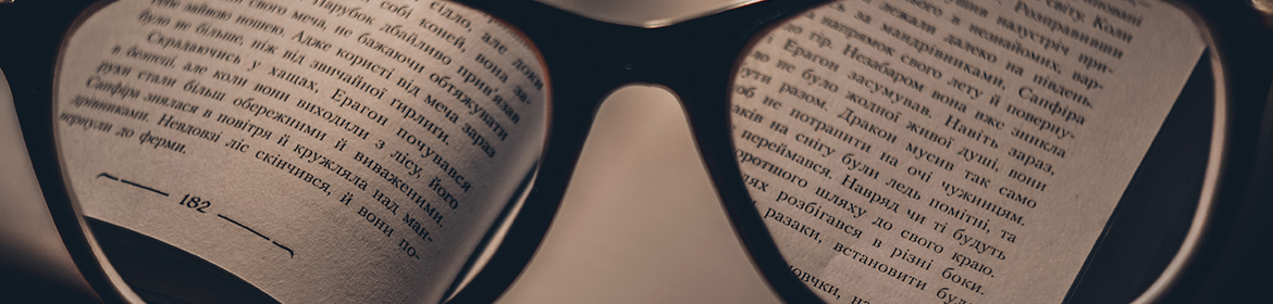Book through reading glasses