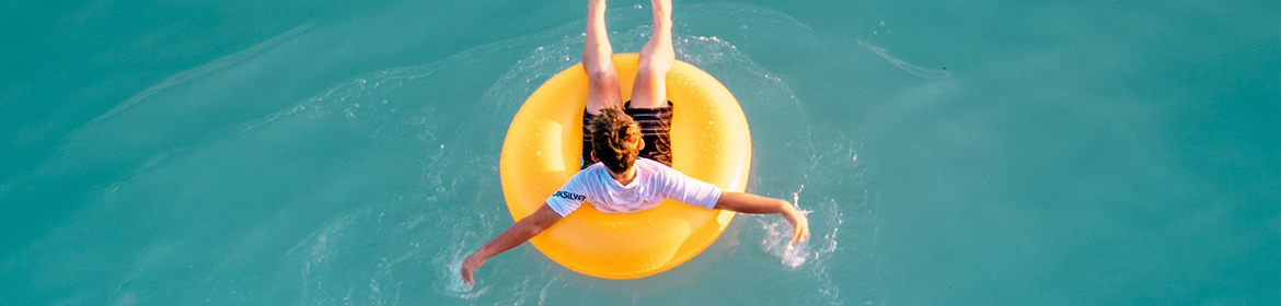 Person lying in inflatable ring