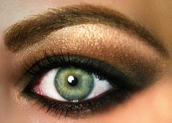 Close up of green smoky eye makeup