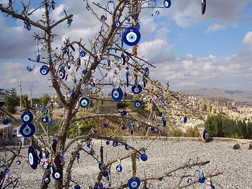Glass amulets hung in a tree to protect against the evil eye