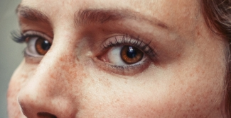 Close up of woman with brown eyes