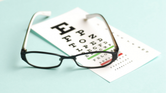 eye chart and pair of specs