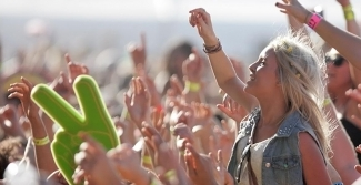 Outdoor festival showing people with hands up