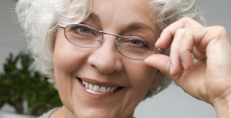 Woman over 60 wearing glasses