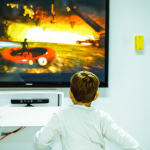 Child sitting in front of television
