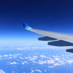 Airplane soaring through a big blue sky