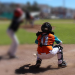 Children playing baseball with myopia vision